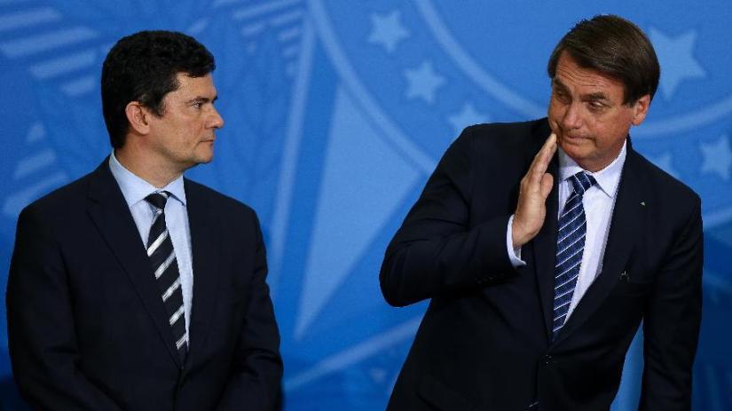 o-presidente-jair-bolsonaro-e-ministro-sergio-moro-justica-durante-lancamento-no-planalto-de-programa-contra-violencia-nas-cidades-1567112591028_v2_900x506